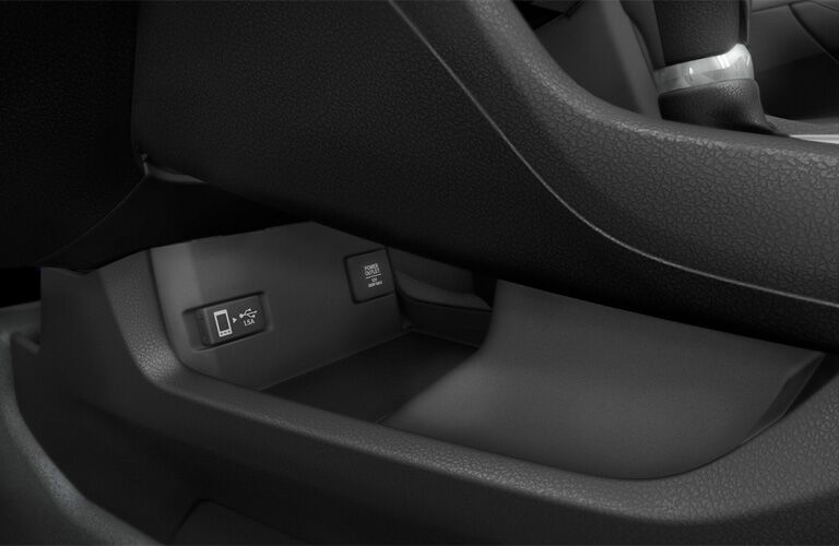 A photo of a storage tray in the 2019 Honda Civic Coupe.