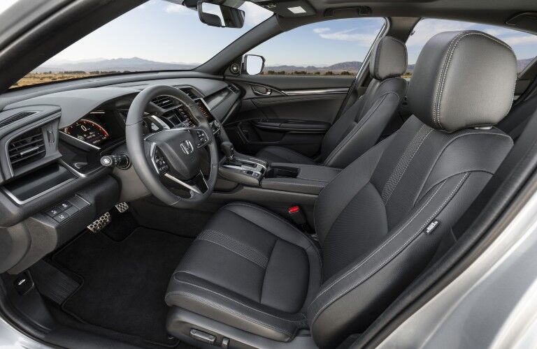 A photo of the front seats in the 2021 Honda Civic Hatchback.