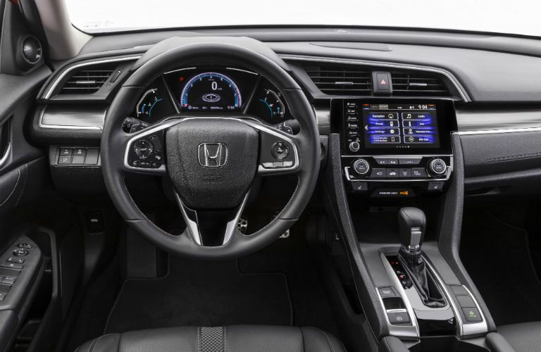 A photo of the driver's cockpit in the 2020 Honda Civic Sedan.