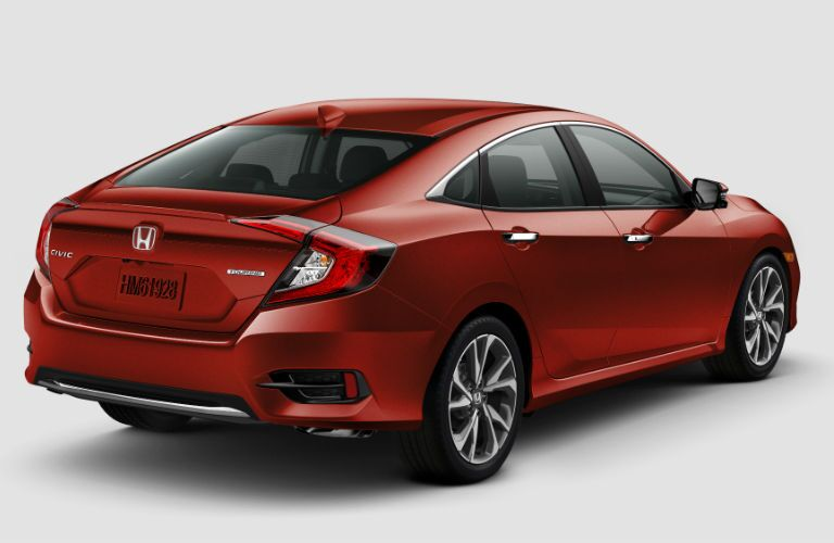 A rear right quarter photo of the 2019 Honda Civic Sedan.