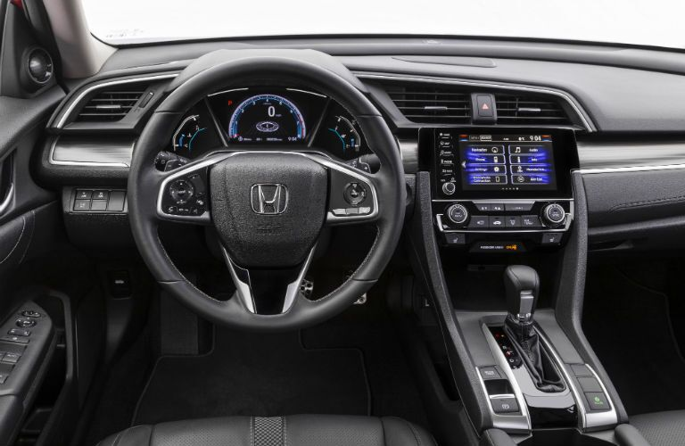 A photo of the driver's cockpit in the 2021 Honda Civic Sedan.