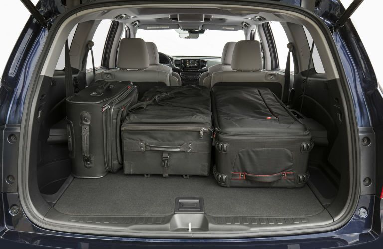 A photo of the luggage in the cargo area of the 2020 Honda Pilot.