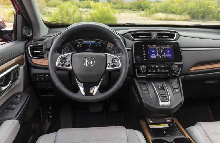 A photo of the driver's cockpit in the 2021 Honda CR-V Hybrid.