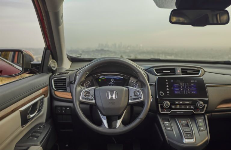 A photo of the driver's cockpit in the 2020 Honda CR-V Hybrid.
