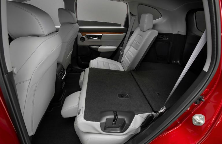 A photo of the rear seats with one folded down in the 2020 Honda CR-V Hybrid.