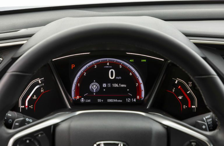 A photo of the center gauge cluster in the 2019 Honda Civic Coupe.