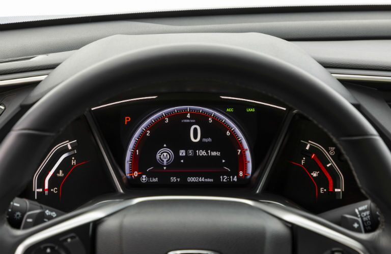 A photo of the center gauge cluster used by the 2020 Civic Coupe.