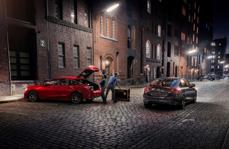 Two 2022 Honda Civic Hatchback models parked in an alley.