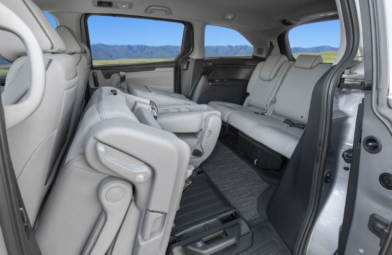 A photo of the folded second row of seats in the 2021 Honda Odyssey.
