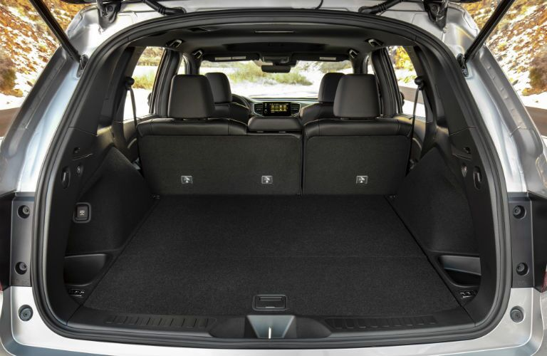 A photo of the cargo area in the rear of the 2021 Honda Passport.