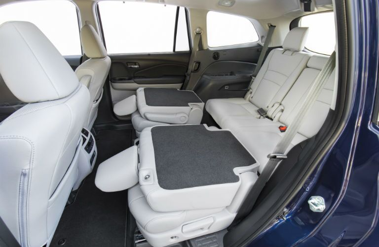 A photo of the second row folded down in the 2021 Honda Pilot.