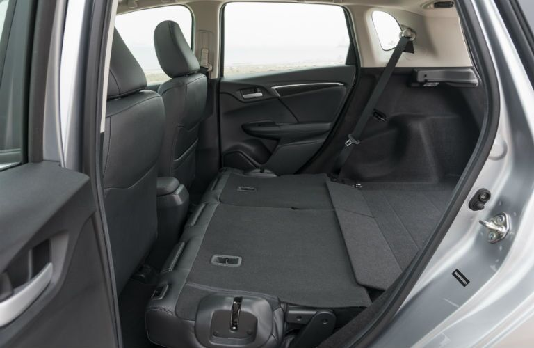 A photo of the rear seats of the 2019 Fit folded down for max cargo space.