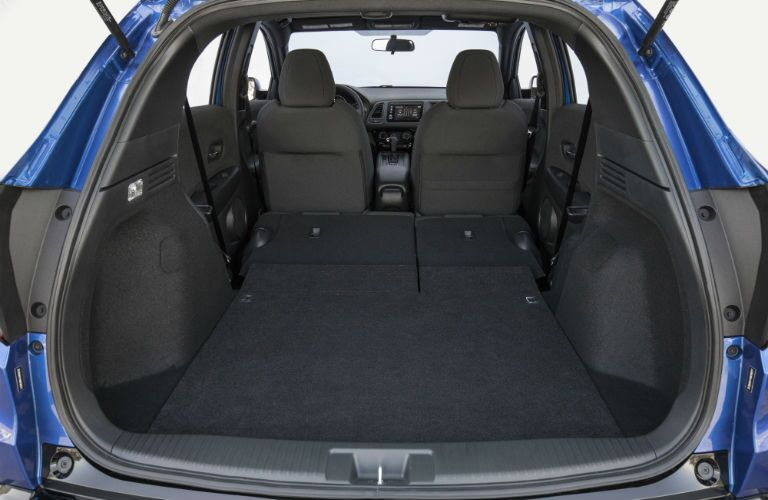 An interior photo showing the rear seats folded down for maximum cargo capacity.