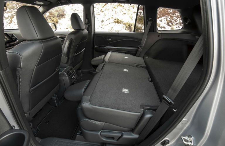 A photo of the back seats folded down in the 2019 Passport.