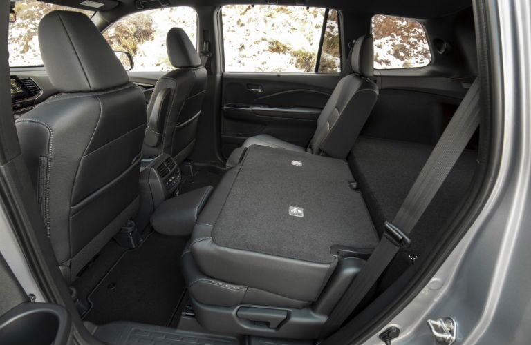 A photo of the rear seats folded in the 2020 Honda Passport.