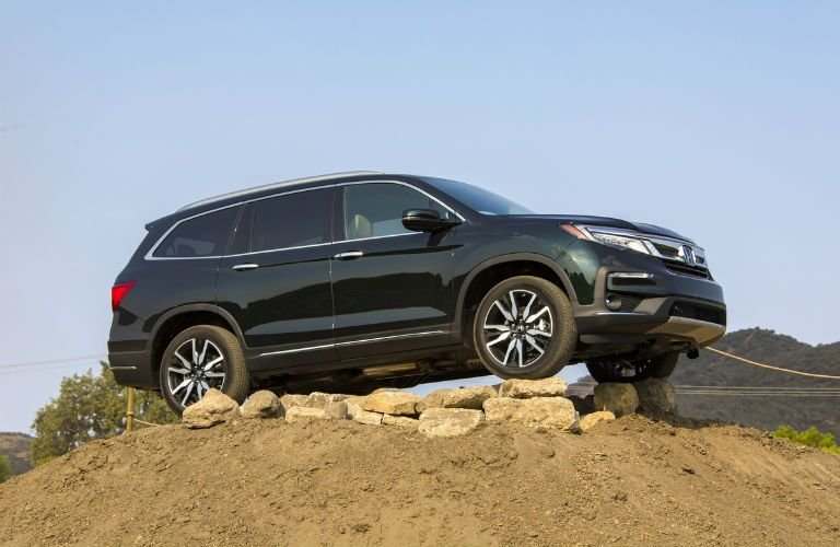 A photo of the 2020 Honda Pilot parked on a hill.