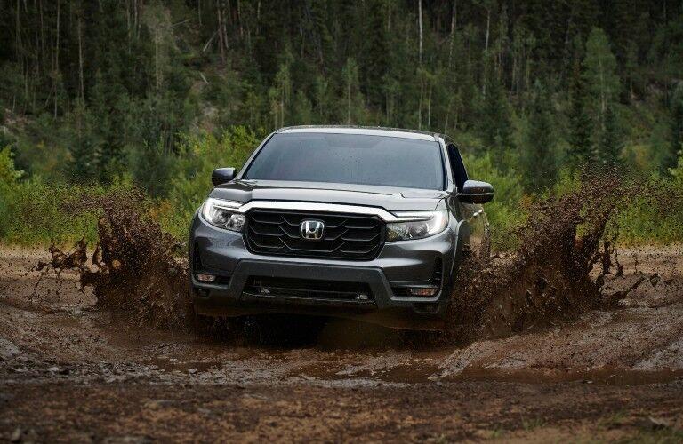 A photo of the 2021 Honda Ridgeline going through the mud.