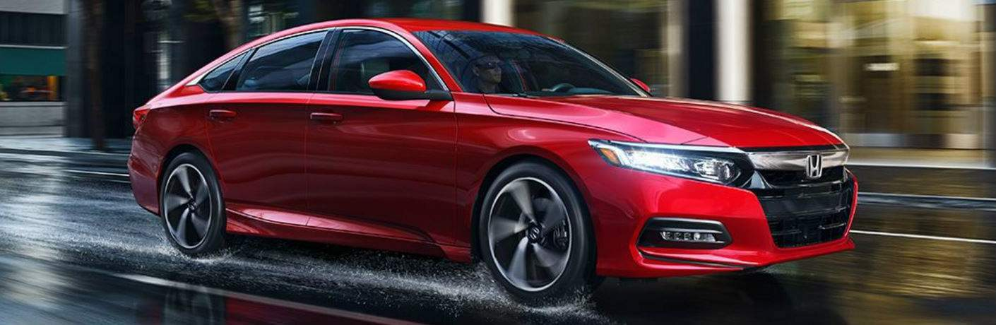 red 2018 Honda Accord driving on wet road