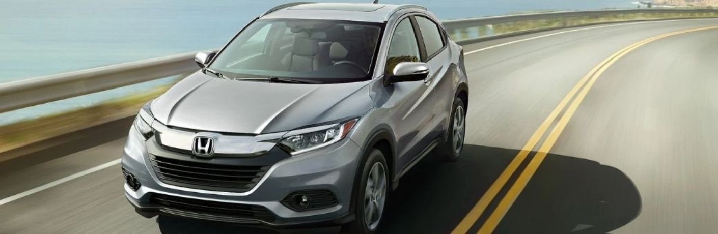 The 2022 Honda HR-V in silver while on road