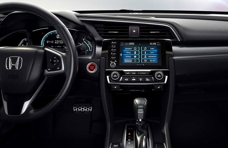 View of the steering wheel and infotainment system of the 2021 Honda Civic Coupe
