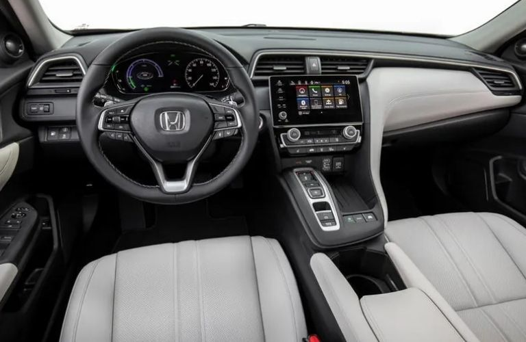 View of the steering wheel, the infotainment system and entire front console of the 2022 Honda Insight Hybrid