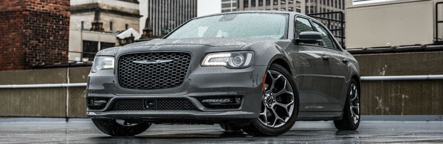 A front quarter photo of the 2018 Chrysler 300 parked on top of a building.