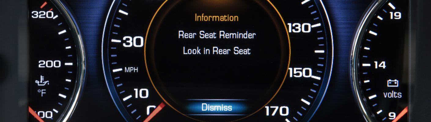 A close up photo of the symbology of the rear-seat reminder system in the 2019 GMC Acadia.