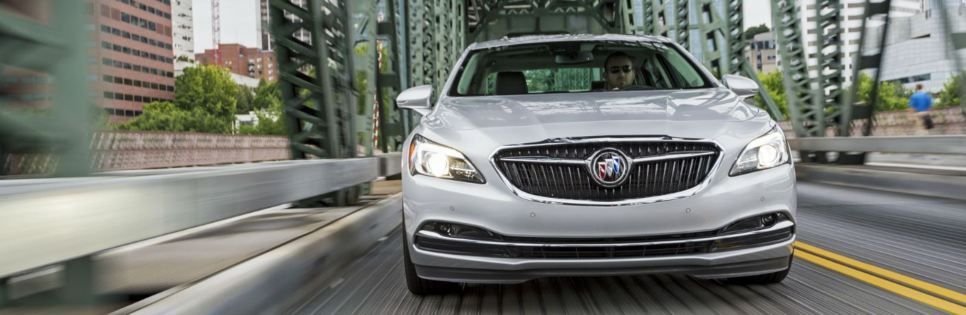 A head-on photo of the 2018 Buick LaCrosse driving over a bridge.