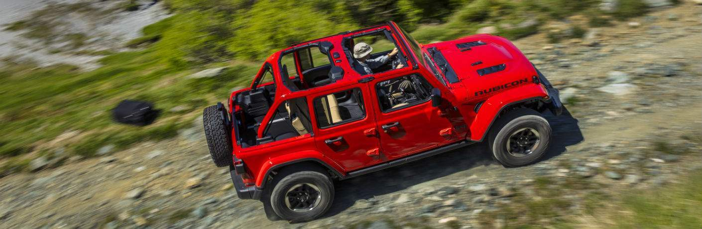 An overhead view of a red 2018 Jeep Wrangler on a rocky off-road trail