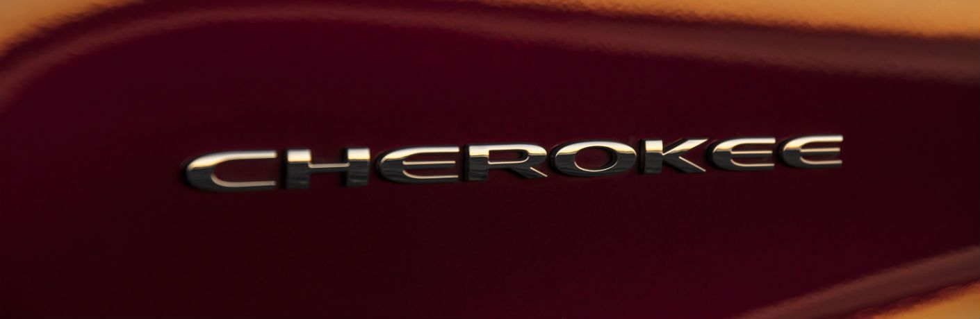 A close up photo of the Cherokee badge worn by the 2019 Jeep Cherokee.