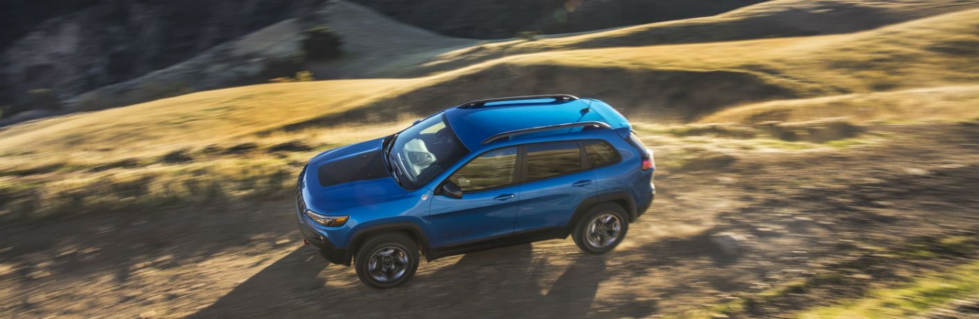 An overhead photo of the 2019 Jeep Cherokee Trailhawk driving over a trail.
