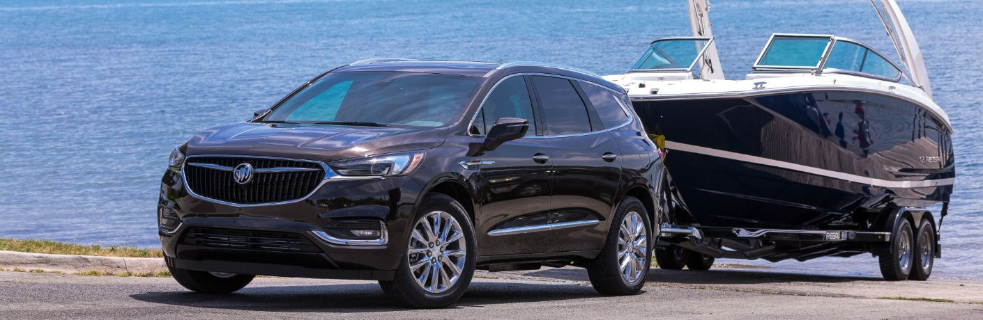 A photo of the 2019 Buick Enclave pulling a boat out of the water.