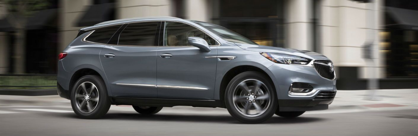 A right profile photo of the 2019 Buick Enclave on the road.