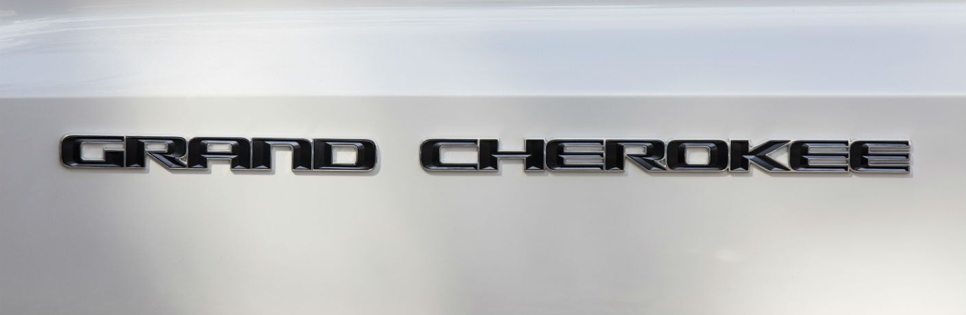 A close up photo of the Grand Cherokee badge on the 2019 Jeep Grand Cherokee.