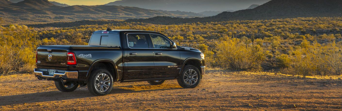 A right profile photo of the 2019 Ram 1500 parked in the desert.