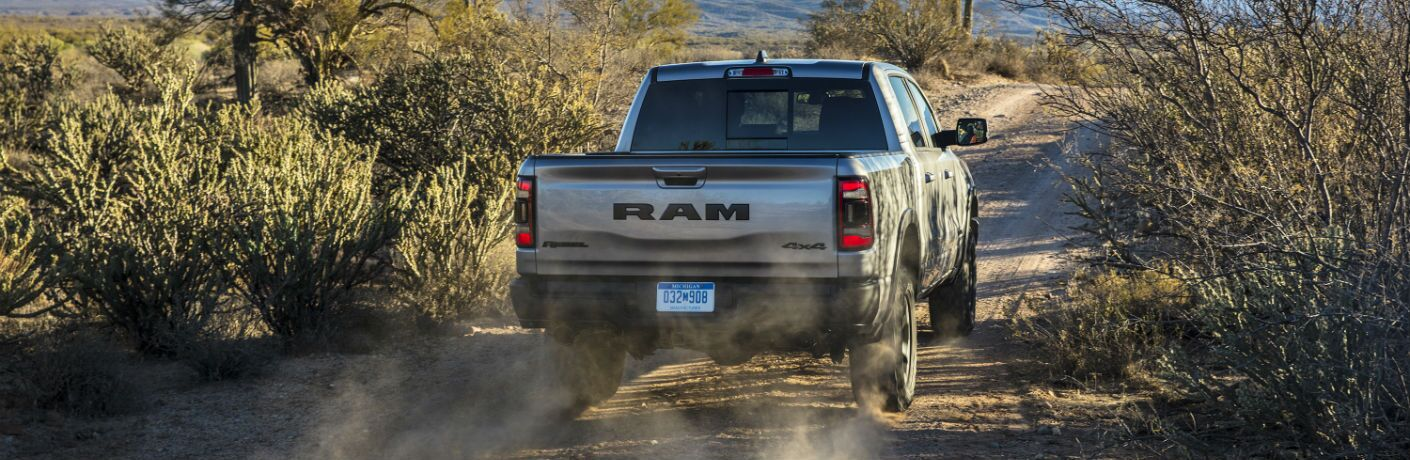 A rear photo of the 2019 Ram 1500 driving away from the camera.