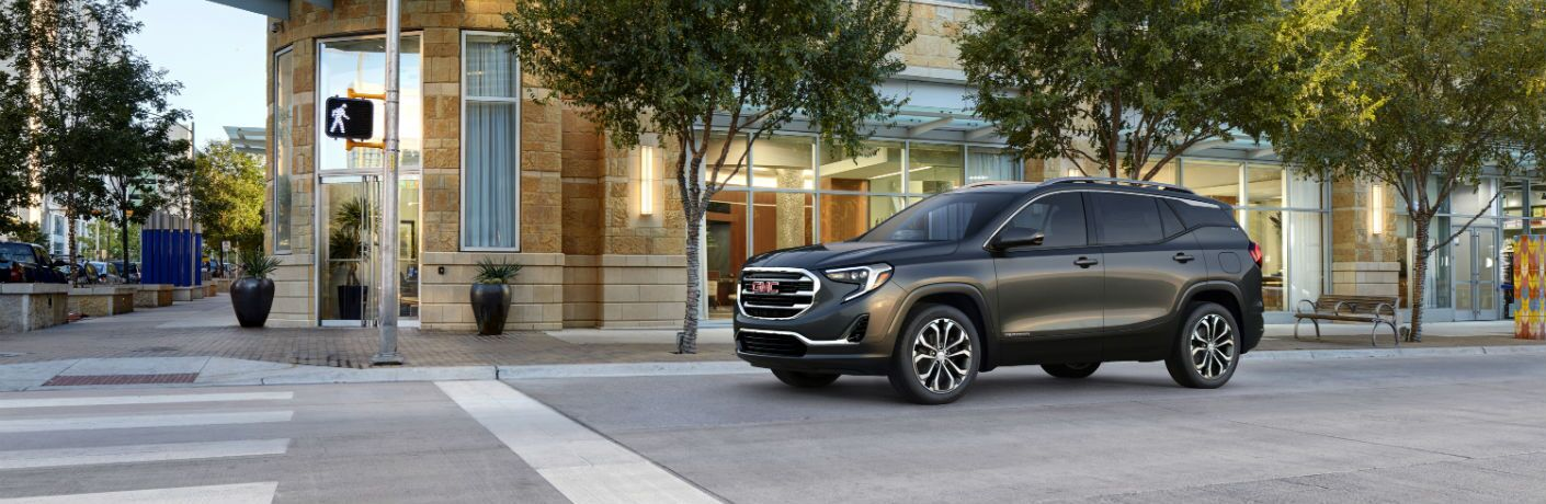 A left profile photo of the 2019 GMC Terrain at a stop light.