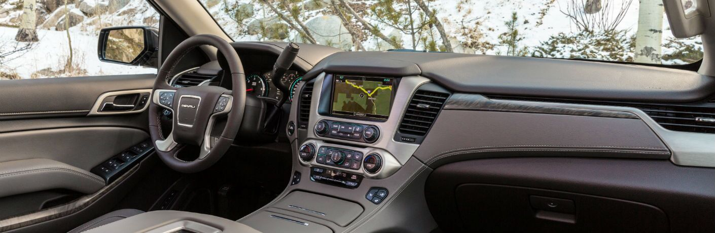 An interior photo of the front dashboard in the 2019 GMC Yukon.