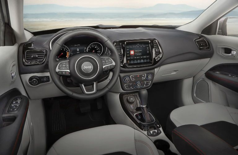 An interior photo of the dashboard in the 2019 Jeep Compass.
