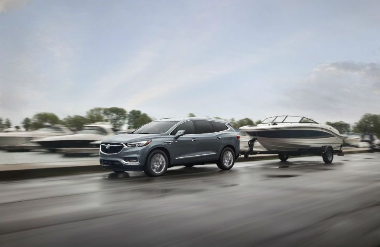 A photo of a the 2019 Enclave pulling a boat.