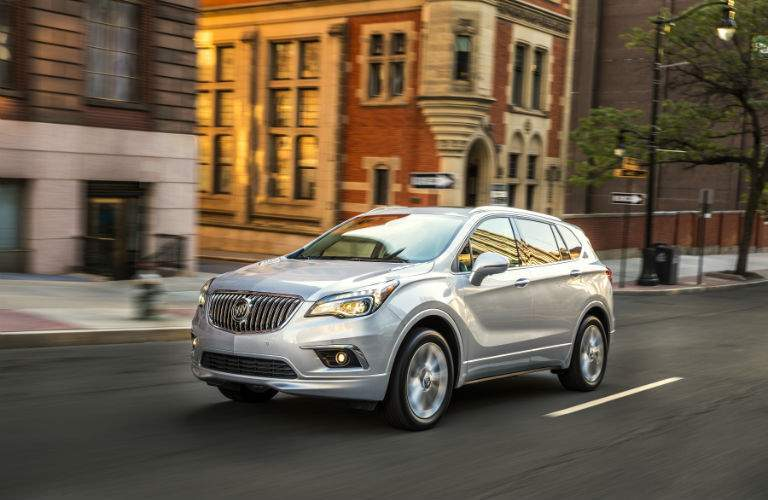 A front left quarter photo of the 2018 Buick Envision driving on a city street