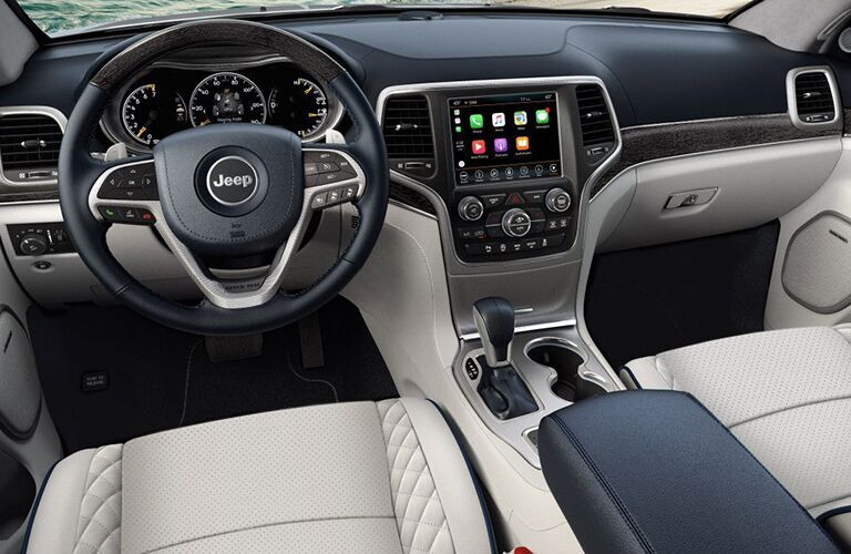 A photo of the dashboard and driver's cockpit in the 2019 Jeep Grand Cherokee.