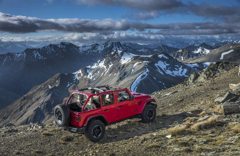 An elevated view of the 2018 Jeep Wrangler driving over a mountainous trail