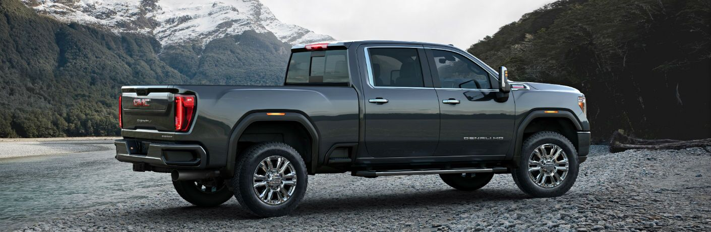A right profile photo of the 2020 GMC Sierra 2500HD parked by a river.