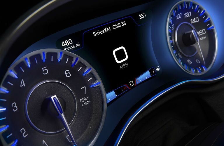A close up photo of the center gauge cluster of the 2018 Chrysler 300.