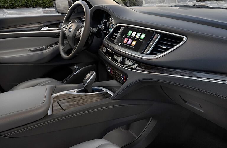 A photo of the front dashboard and available technology in the 2018 Enclave.