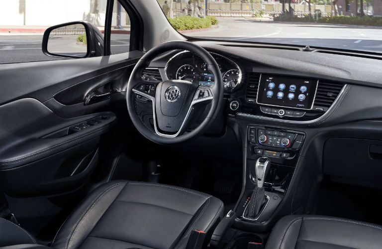 An interior photo of the driver's cockpit in the 2019 Encore.