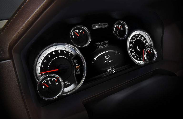 A close up photo of the gauge cluster in the 2018 Ram 1500 showing the integrated trailer brake display