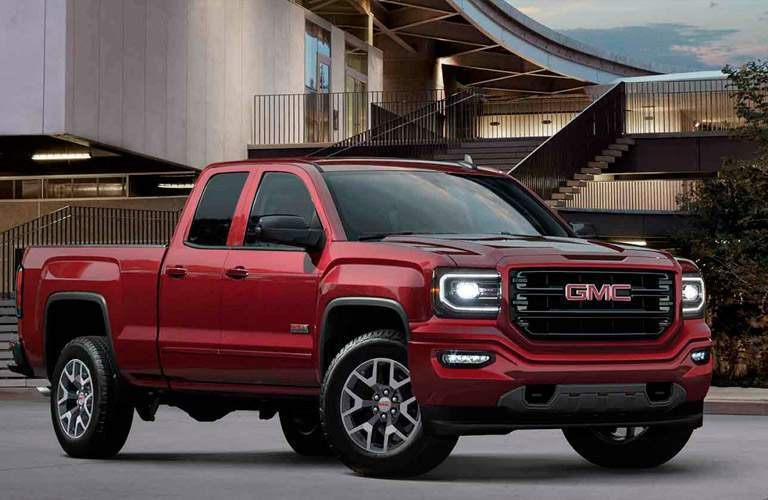 2017 GMC Sierra in Red shows off potential model during Billion Auto Group October sale