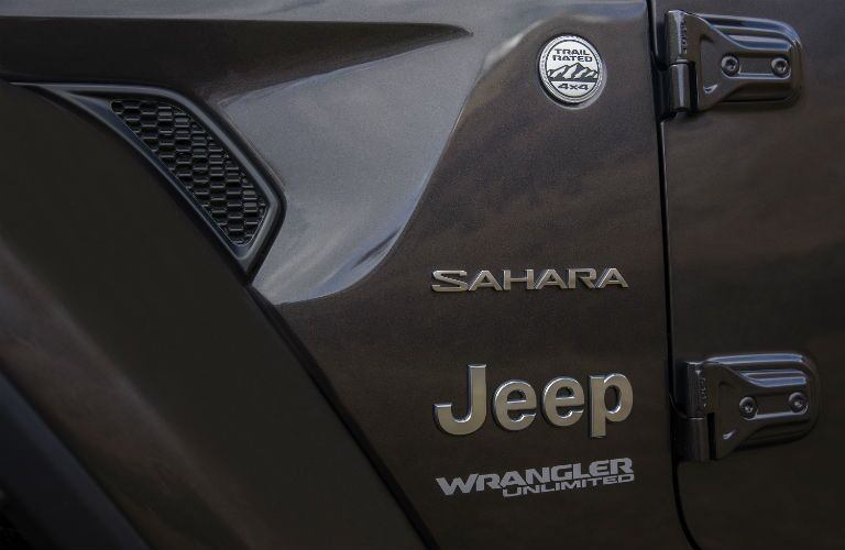 A photo of the Sahara badge on the 2019 Wrangler Sahara.